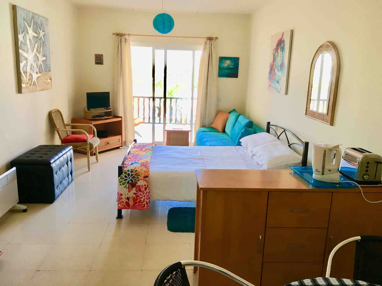 Double bed, TV, satellite box, sofa, balcony