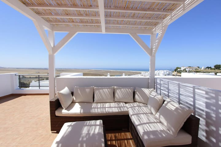 Casa Feliz - Modern terraced house with fantastic sea views and communal pool