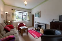 Cosy living room, for sitting and relaxing, talking and telling stories.
