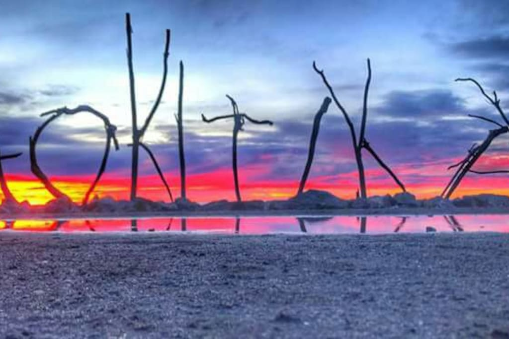 Wicked Hokitika sunset - you'll find the driftwood sign on the beach behind the town centre.