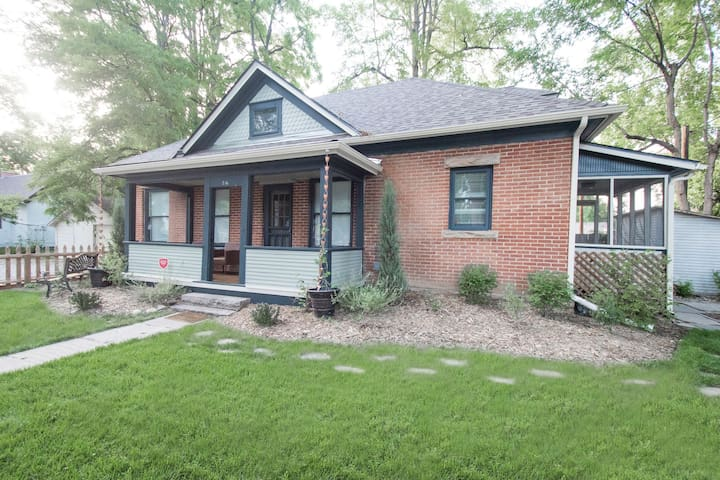 Here is the front of the house--set with a beautiful patio and green grass!