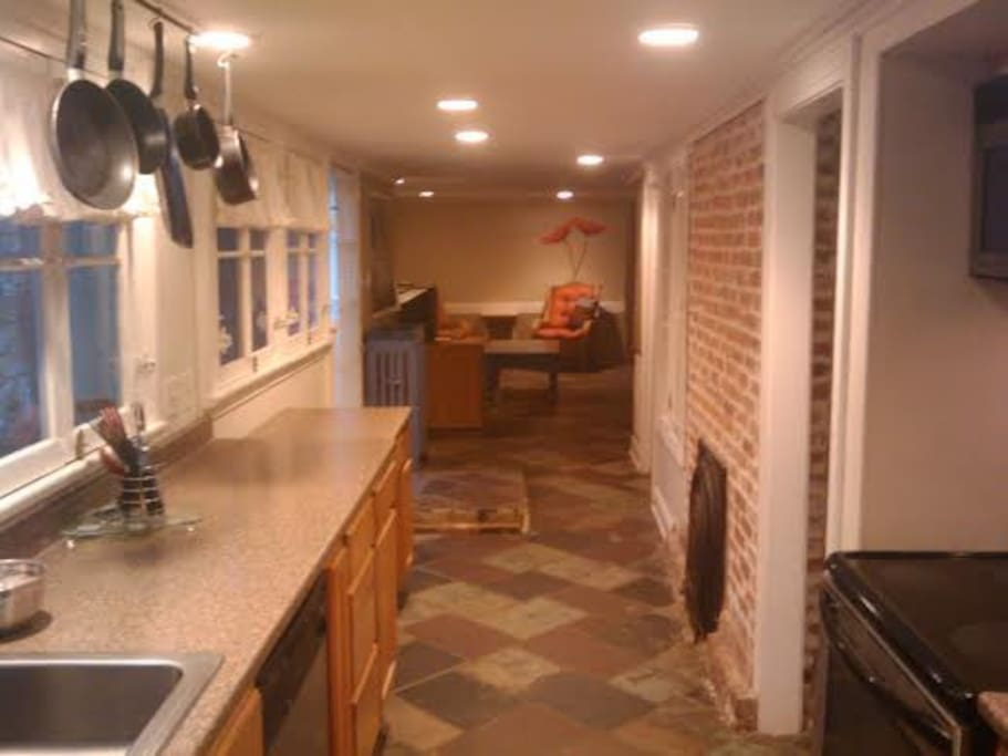 Front door/galley style kitchen