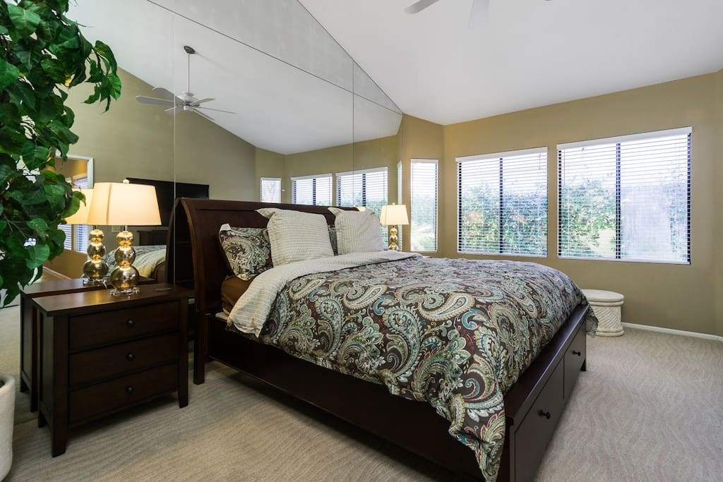 The king-size master boasts vaulted ceilings