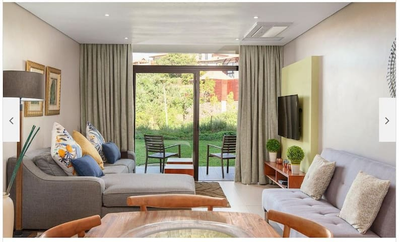 Open plan living area with DSTV. There is a double bed pullout couch.