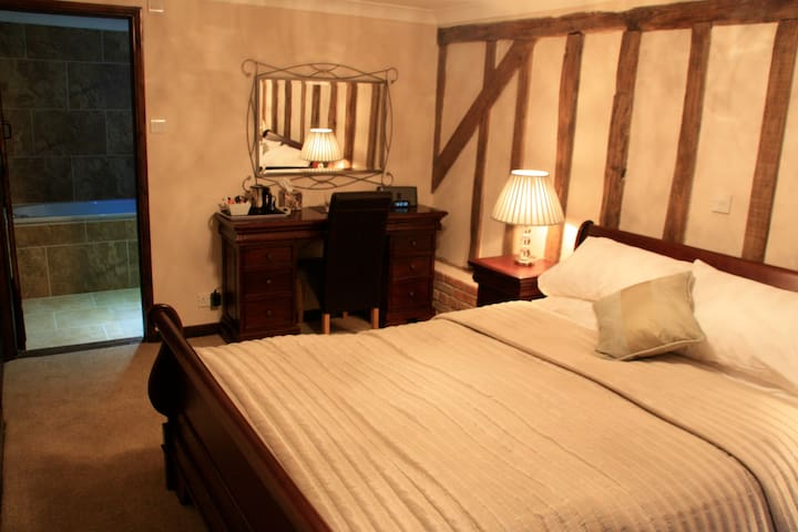 Double room with king size sleigh bed and comfy mattress (so we are often told!)