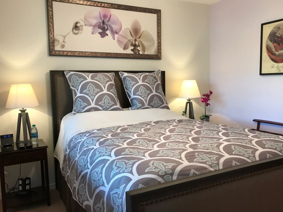 The Nordic Suite has luxurious bedding and view of Willow Tree.