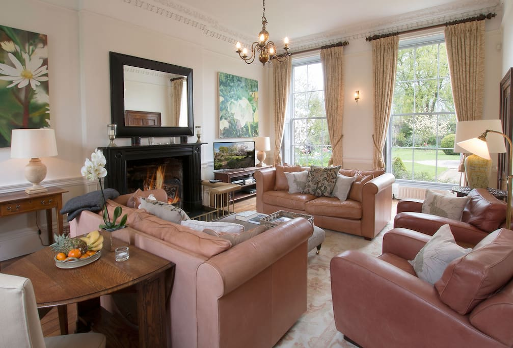 Ground floor: Sitting room with open fire and dining area