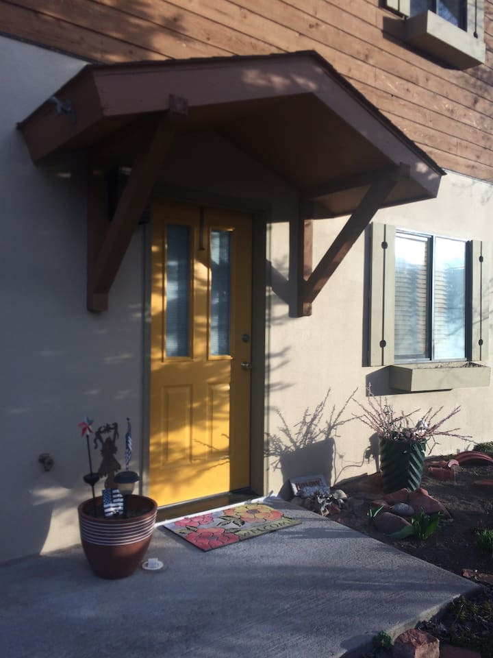 Gold door ENTRY to the house& your 2 bdrm comfortable accommodations!