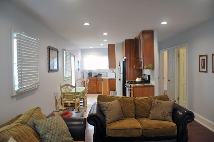 open concept floor plan from living room leading into dining area & kitchen