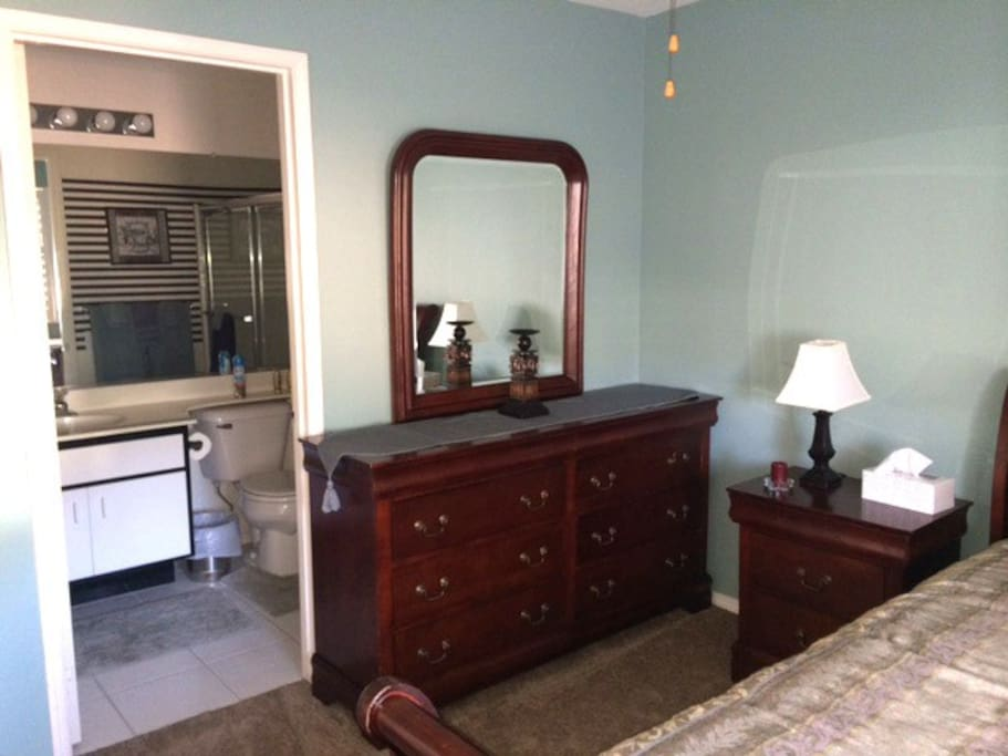 Bedroom contains a dresser with vanity mirror, and full en-suite bathroom, in addition to Queen memory foam mattress and full closet.