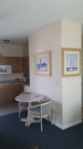 Small dining table and chairs, full kitchen minus an oven
