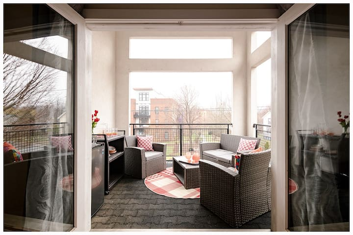 The primary bedroom on the 2nd floor leads out to a large loggia, with a fridge and coffee maker and views of the iconic coal tower and area mountains and gardens.