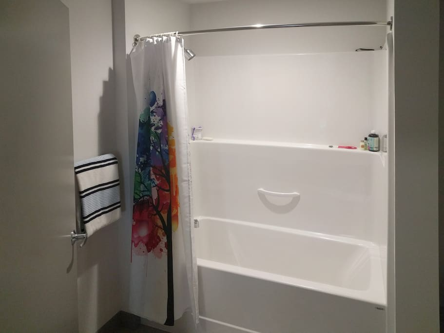 shower - full sized shower bathtub with towels