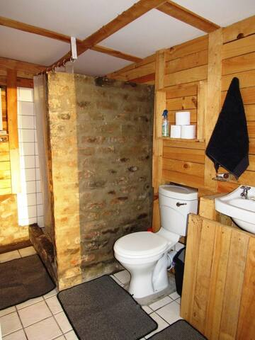 Separate bathroom between 2 bedrooms with toilet, basin and shower with hot water