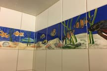 Hand-painted tile in the shower