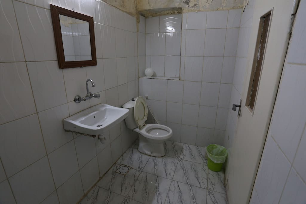 Spacious bathroom with hot water