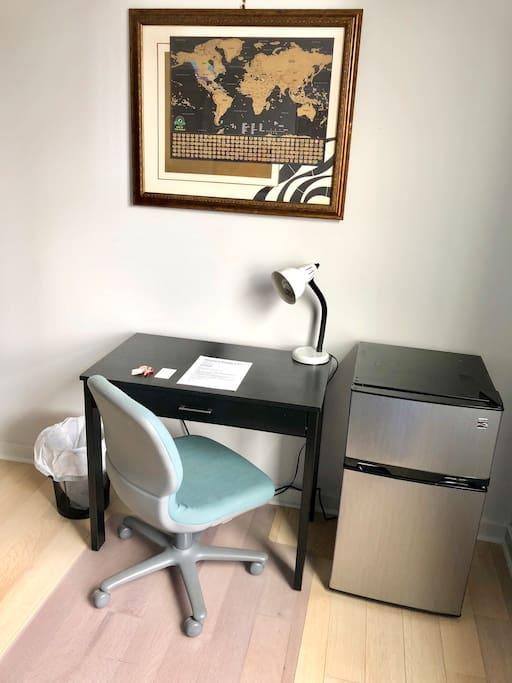 Desk space and mini fridge in your private bedroom