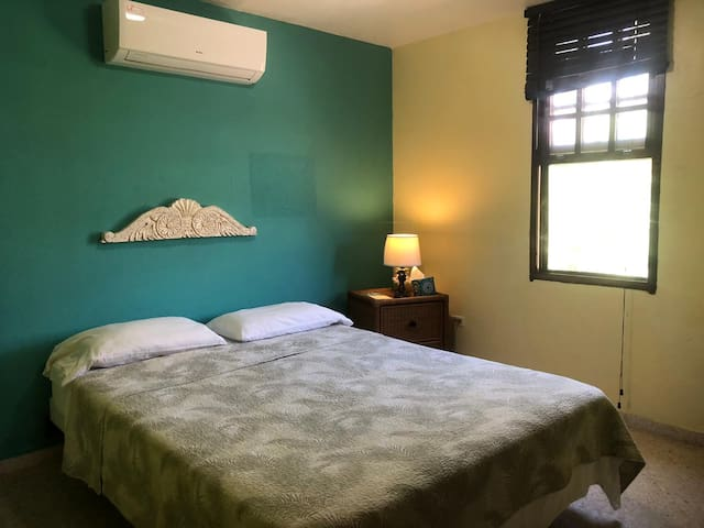 Master bedroom has a Queen sized bed and a beautiful garden view.  This is an airconditioned room.