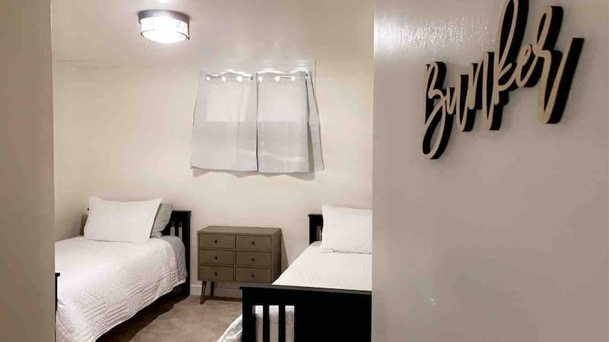 """*Bunker* Bedroom on basement level next to the lower level hall bathroom. Two twin beds with 8"""" memory foam mattress, and full size closet."""