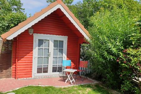 Tinyhouse am Fluss, im Zentrum, strandnah, Netflix