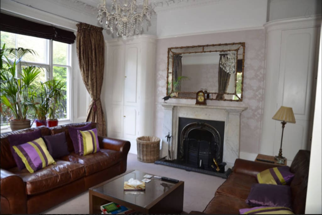 One of two sitting rooms with open fire