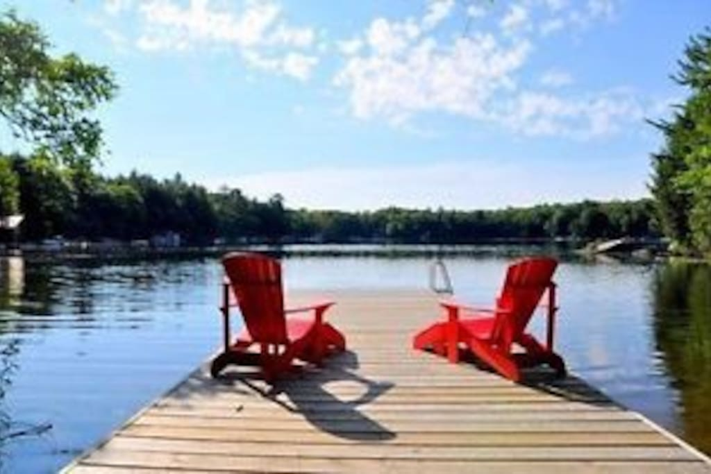 Muskoka chairs on the dock.