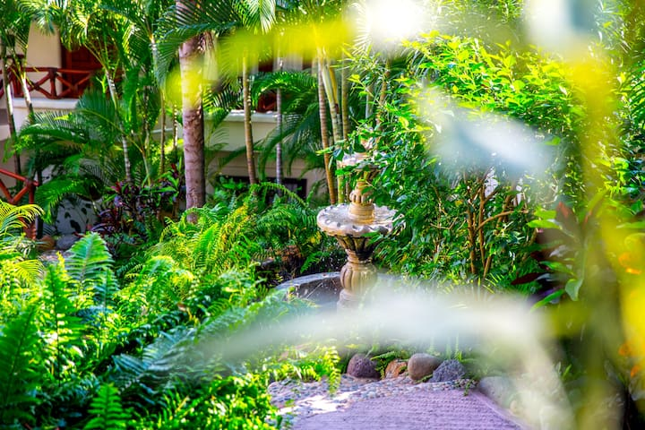 The lush landscaped gardens.