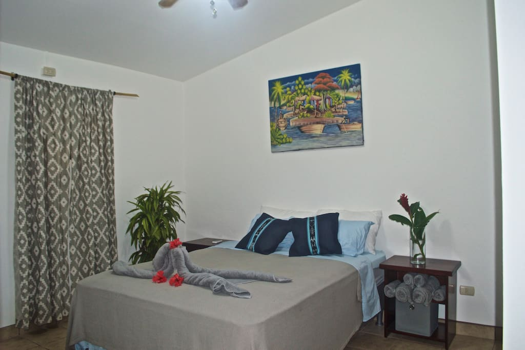 Air conditioned bedroom with ceiling fan and comfortable Queen Size bed