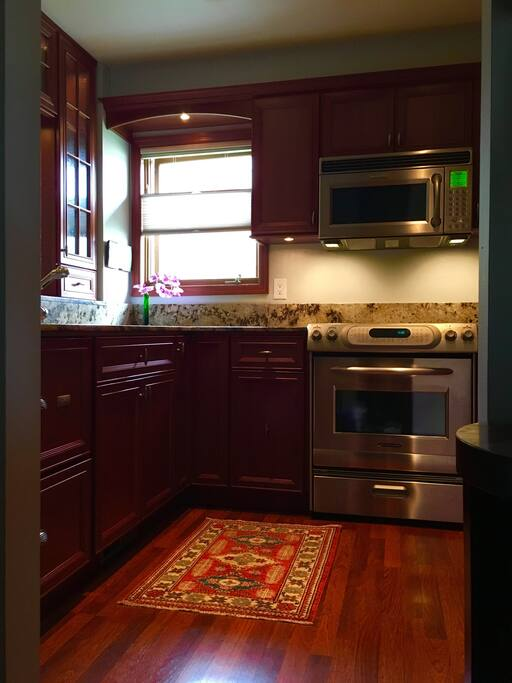 Custom kitchen. Fully stocked spices, french press, Vitamix, convection oven, cooktop, microwave and dishwasher.
