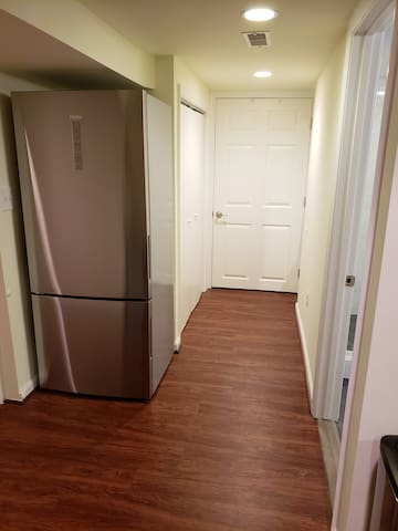 Large stainless steel refrigerator with freezer.