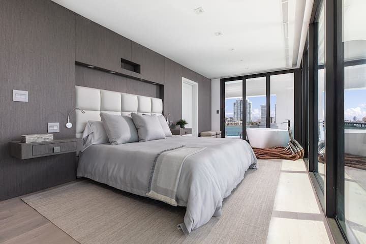 Master bedroom with en suite bath and private balcony at the bow