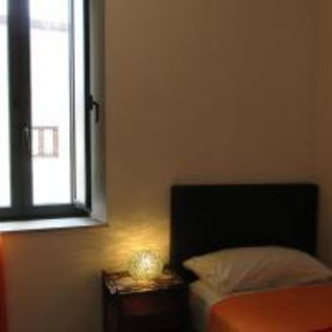 Single bedroom has a window overlooking a quiet courtyard.