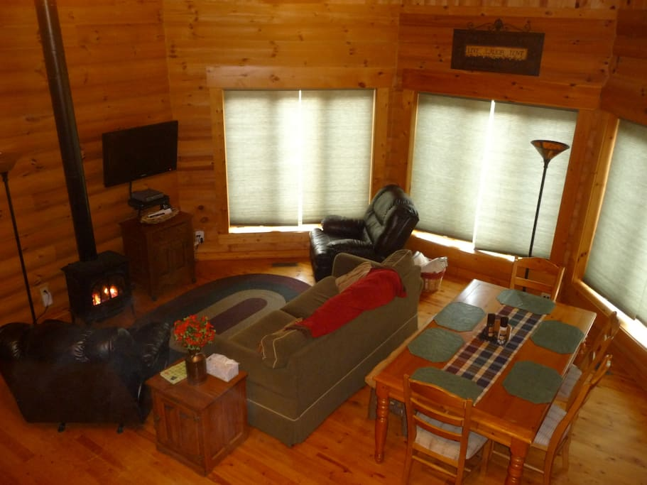 Enjoy family time in our warm log great room!