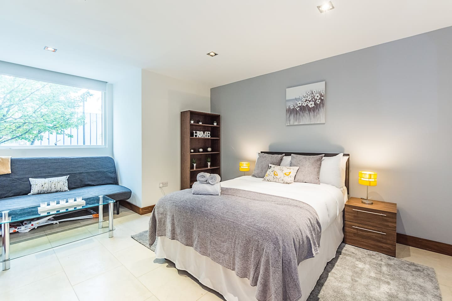 Your first large double suite features a double bed, dressed with hotel quality towels and linen for your stay. There are two wardrobes and a sofa and coffee table.