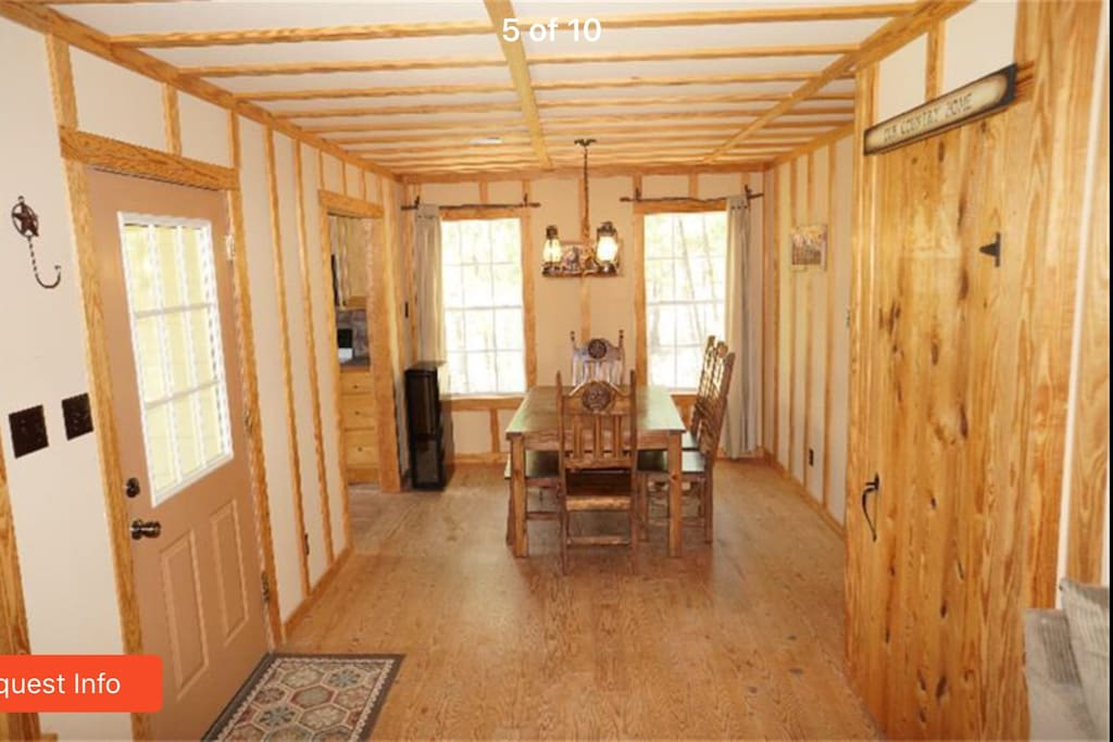 Inside the cabin , wooded rustic dining area