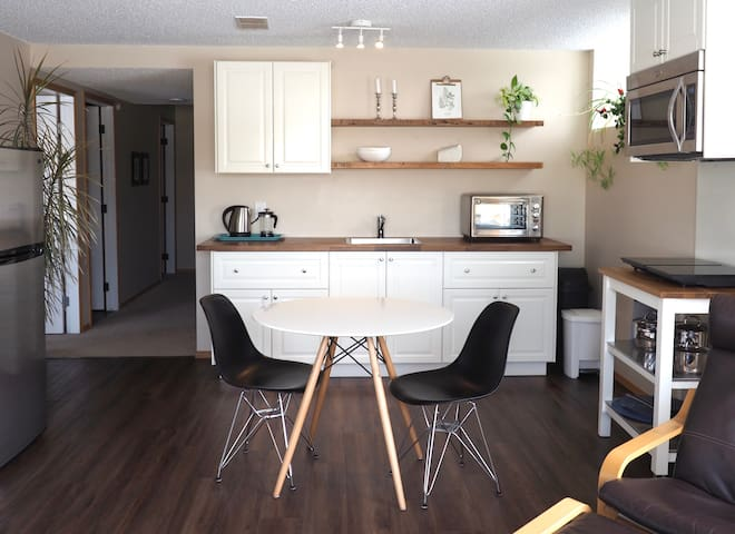 A home away from home!  Bright and comfortable 2 bedroom basement suite near Okotoks Recreation Centre.