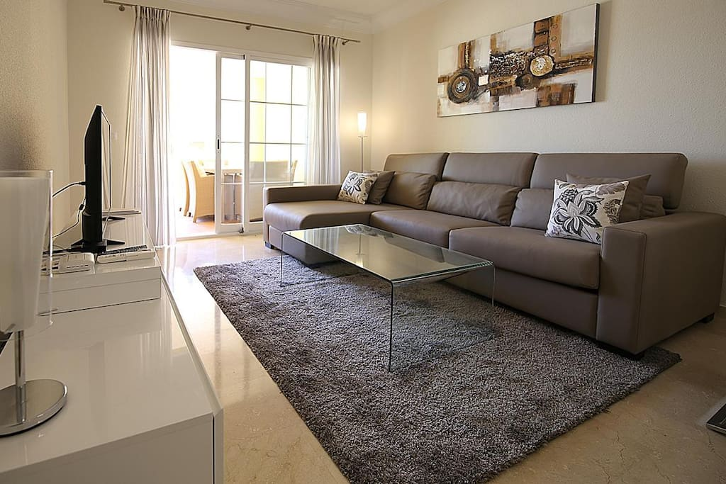 Contemporary and comfortable lounge with access to the terrace
