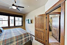 """The master bedroom is outfitted with a 40"""" Roku TV and an en-suite bathroom."""