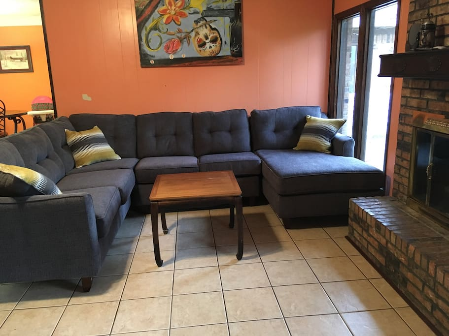 Common living room with brand new sectional provides plenty of room for guests. Wood burning fireplace available for those cold rainy days.