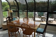 Sunroom off of the kitchen and dining room