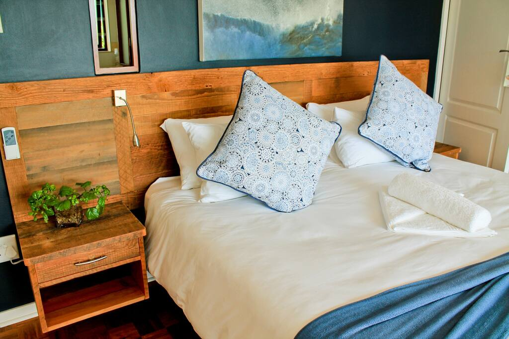Stunning en-suite bedroom with king-size bed, veranda access and ocean view