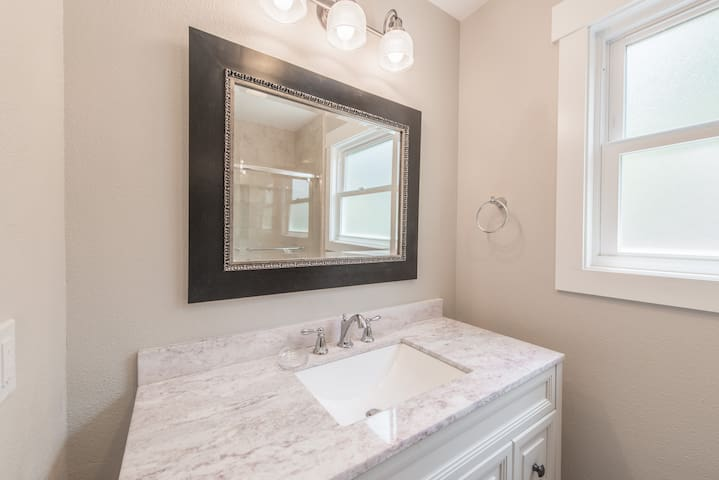 Freshen up with the Carrara marble vanity in the 2nd bathroom.