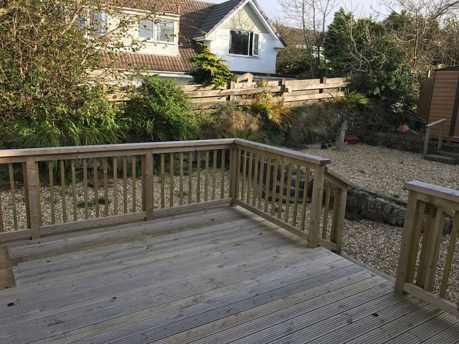 Garden deck, ideal for al-fresco dining. Lovely view over to the moor