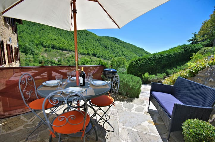 Private terrace with dining table and BBQ