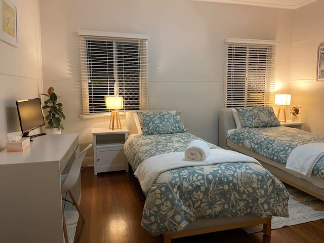 The third bedroom can be setup as two king single beds or a full king size (just let us know what you prefer). Room includes study desk with PC monitor and two large wardrobes.