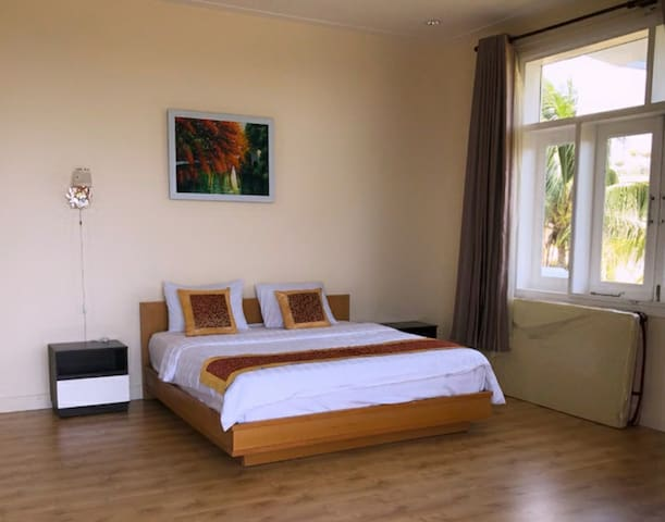 Big bedroom with queen size bed and floor mattresses added for more people