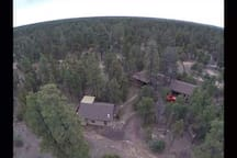 Drone aerial photo of the two cabins for rent and fire pit area, garage not available.