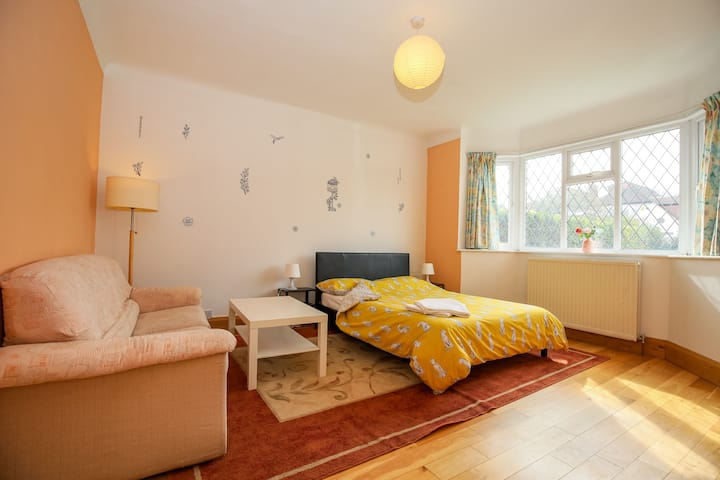 Large Room in Happy Home (with parking space)