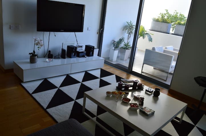 living room area. large 40 inch TV which can also be enjoyed while sitting outside. Netflix, stereo system, high speed internet