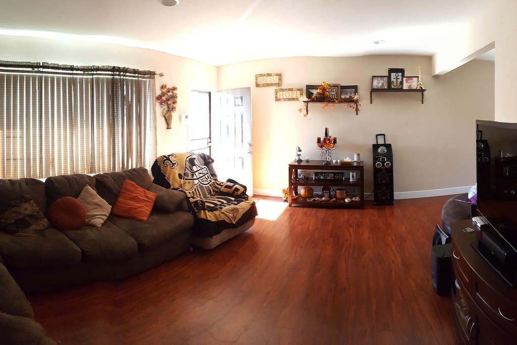 Spacious living area with full entertainment system.